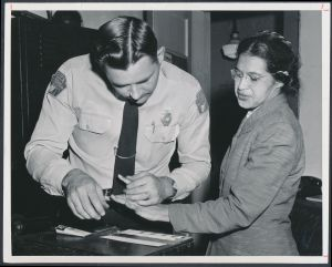 Rosa_Parks_being_fingerprinted_by_Deputy_Sheriff_D.H._Lackey_after_being_arrested_for_boycotting_public_transportation_-_Original