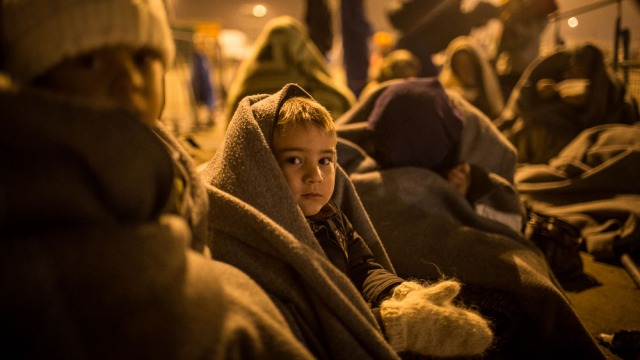http://www.irinnews.org/photo/child-waits-line-group-refugees-border-between-austria-and-hungary-nickesld